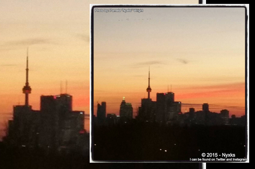 Image shot though a window of the Toronto Skyline at Sunset